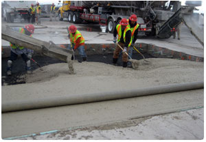 Men placing Rapid Set concrete