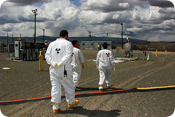 Image of workers in protective clothing on the Savannah River Site